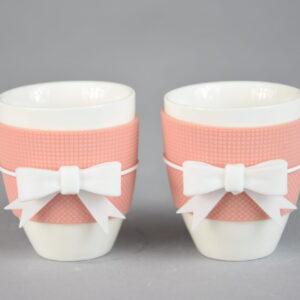 Set due tazzine caffe'  colore tortora con fiocco bianco.