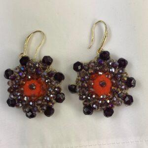 Orecchino Produzione artigianale con perline stella colore arancio.