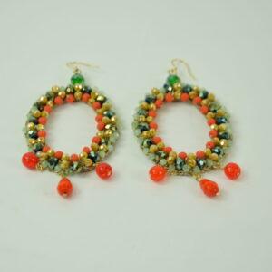 Orecchino donna nostra produzione artigianale colore arancio/beige un cerchio con perline colorate e tre pendenti due palline e un ciondolo  collezione primavera estate 2019