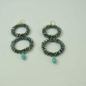 Orecchino donna nostra produzione artigianale due cerchi colore grigio con perline e un pendente colore azzurro collezione primavera estate 2019