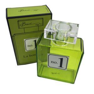 Bottiglia vuota porta profumo colorata verde.
